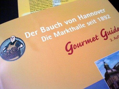 Werbung mit dem Titel: Der Bauch von Hannover -- Die Markthalle seit 1892 -- Gourmet Guide 2. Auflage
