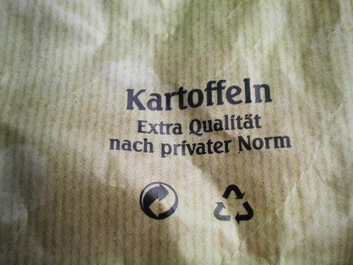 Foto eines Aufdruckes auf einer Kartoffeltüte von Aldi Nord: Kartoffeln. Extra Qualität nach privater Norm.