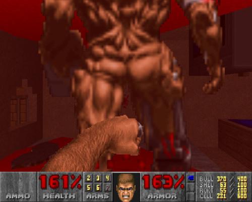 Screenshot aus einem DooM-WAD: Ein Cyberdemon wird in den Arsch geboxt